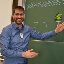 Prof. Michael Eisermann an der Tafel Vorlesung Spieletheorie